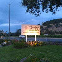 Photo taken at Brix Restaurant and Gardens by Victor Z. on 8/5/2012