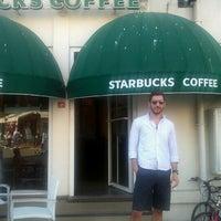 Photo taken at Starbucks by Dogukan O. on 5/6/2012