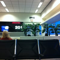 Photo taken at Gate 201 by Joshua B. on 3/11/2012