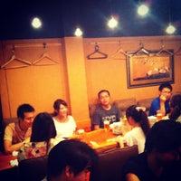 Photo taken at 四万十 by Hirohisa T. on 7/27/2012