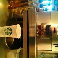 Photo taken at Starbucks by Melanie J. on 8/11/2012