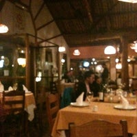 Photo taken at Restaurant La Rueda 1975 by Joao Carlos L. on 8/28/2012