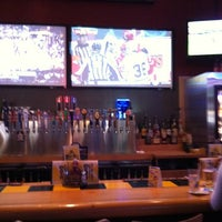 Photo taken at Buffalo Wild Wings by Stephanie R. on 3/4/2012