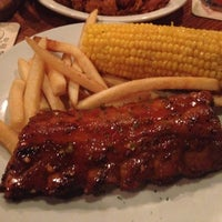 Photo taken at Outback Steakhouse by Lou C. on 9/5/2012