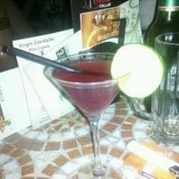 Photo taken at Alibi Café & Cocktails by Esztus N. on 8/22/2012