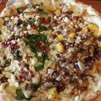 Photo taken at Kaleidoscope Pizzeria & Pub by Christine K. on 3/26/2012