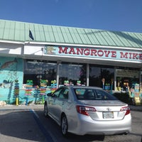 Photo taken at Mangrove Mike's Cafe by Michele A. on 8/19/2012
