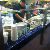 Photo taken at Cafe Rio Mexican Grill by Steven C. on 3/1/2012