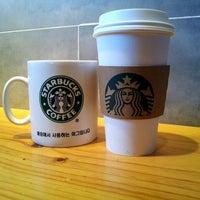 Photo taken at Starbucks by eunmi c. on 9/8/2012