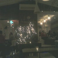 Photo taken at Tramonto cafe by Leonidas M. on 1/1/2012