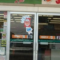 Photo taken at 7-Eleven by Ella on 7/5/2012