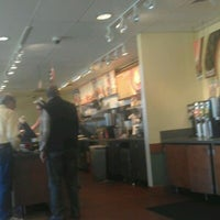 Photo taken at Einstein Bros Bagels by Mike S. on 10/31/2011