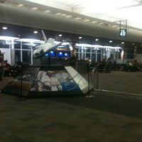 Photo taken at Gate 47 by Lauren H. on 10/14/2011