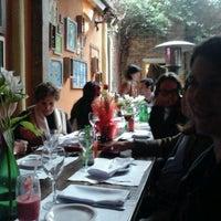 Photo taken at Oliva Restaurante by Melissa d. on 5/13/2012