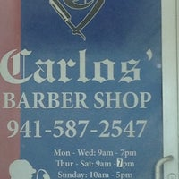 Photo taken at Carlos' Barber Shop by Pris C. on 7/8/2012