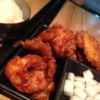Photo taken at BonChon Chicken by Pawanrat S. on 3/23/2012