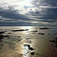 Photo taken at Charmouth Beach by Sian on 1/9/2012