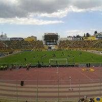 Photo taken at Estadio Olimpico Atahualpa by Sebastian V. on 9/7/2012