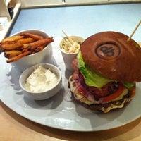 Photo taken at Domyno Burger Bar by Adam on 3/20/2012