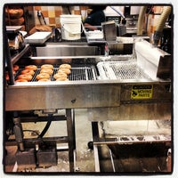 Photo taken at Krispy Kreme Doughnuts by Rob on 7/10/2012
