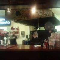 Photo taken at Johnny's Pizza by jeremy b. on 8/12/2011