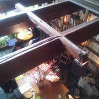 Photo taken at Cafe Bibliotic Hello! by Miura K. on 11/27/2011