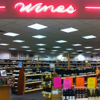 Photo taken at Wine & Spirits by Kelly R. on 2/22/2012