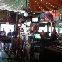 Photo taken at The Green Parrot by T.J. S. on 8/16/2012