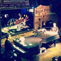 Photo taken at Pete's Dueling Piano Bar by Erin D. on 8/12/2012
