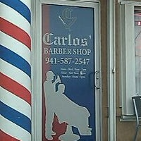 Photo taken at Carlos' Barber Shop by Pris C. on 11/5/2011