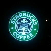 Photo taken at Starbucks by Esteban O. on 12/23/2011