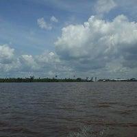 Photo taken at Muara Sungai Kapuas by Aprians G. on 11/21/2011