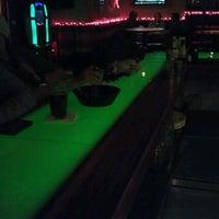 Photo taken at The City Bar & Restaurant by Brett S. on 12/23/2011