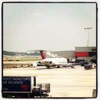 Photo taken at Gate D8 by Jon-Elliott B. on 5/3/2012