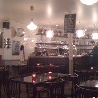 Photo taken at Café Parisien by Emilie S. on 1/30/2011