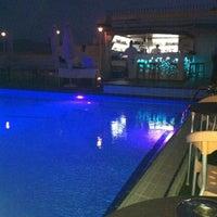 Photo taken at Poseidon Hotel by Zoi K. on 8/12/2012