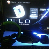 Photo taken at Digital Lounge (DILO) by Eri A. on 12/26/2011