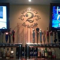 Photo taken at District 2 Bar & Grille by Kristen L. on 1/23/2012