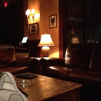 Photo taken at Downing Street Pub & Cigar Bar by T J. on 7/17/2012
