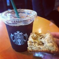 Photo taken at Starbucks by Emiko K. on 5/26/2012