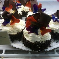 Photo taken at Extraordinary Desserts by Magi on 12/31/2011