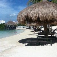 Photo taken at Bluewater Maribago Beach Resort by Gabby L. on 5/8/2012