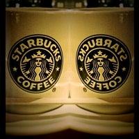 Photo taken at Starbucks by Roxana J. on 4/4/2011