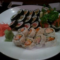 Photo taken at CRAVE American Kitchen & Sushi Bar by Han F. on 8/18/2012