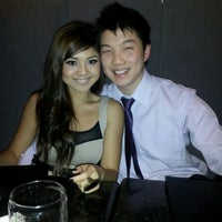 Photo taken at The Office Restaurant & Lounge by Chie C. on 12/18/2011