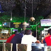 Photo taken at Wing's Army by Juan Pablo C. on 5/28/2011