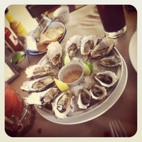 Photo taken at La Docena Oyster Bar & Grill by Diego B. on 6/13/2012