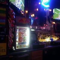 Photo taken at Scalpers Bar & Grille by Scott C. on 10/11/2011