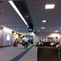 Photo taken at Terminal E by Teresa B. on 7/1/2011