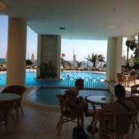 Photo taken at Golden Lotus Hotel by Denis on 8/6/2012
